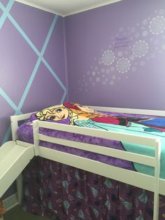 """UPDATE 11/2016- While the low loft bed was fun for awhile, dreams of a """"fort"""" like atmosphere underneath quickly turned into a place to throw things so Mom (me) thinks the room is clean!  It was also difficult to change the sheets.  I am switching this out for a trundle bed with storage drawers.  the Zippy Sac will stay. Frozen girls bedroom.  Frozen Zippy Sac, frozen material from Joann Fabric for curtains.  Blue and purple with silver snowflakes stencil and Simply Said decal in wild…"""