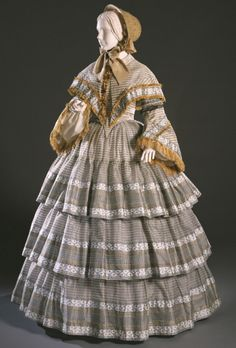 Day Dress and Capelet Artist/maker unknown, American Geography: Made in United States, North and Central America Date: c. 1855 Medium: Light blue, white and black silk in figured and sheer plain weave stripes; silk fringe and tassels Accession Number: 1850s Fashion, Edwardian Fashion, Vintage Fashion, Historical Costume, Historical Clothing, Vintage Dresses, Vintage Outfits, Civil War Fashion, Civil War Dress