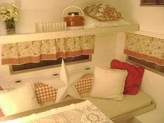 I know this was originally a fold down bed.....but turned into a shelf....cute!  I wanna do this! Would be a cute place to put some glamping items!