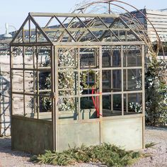 """Made from wrought iron with a new lead finish, this full-sized greenhouse is a striking addition to the landscape. Its open windows welcome climbing vines, while the space inside is perfect for a petite bistro set.- Wrought iron- Indoor or outdoor use- Imported78.7""""H, 59.1""""W, 98.4""""L"""