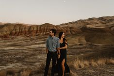 Engagement session at the Painted Hills in Oregon on the most beautiful fall day! Winter Engagement Photos, Engagement Photo Outfits, Fall Engagement, Engagement Couple, Engagement Shoots, Creative Couples Photography, Couple Photography, Wedding Photography, Planning A Small Wedding