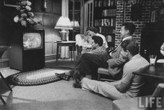 The Nelson Family - Harriet, Ricky, Ozzie, David - watching their TV show. 1950s