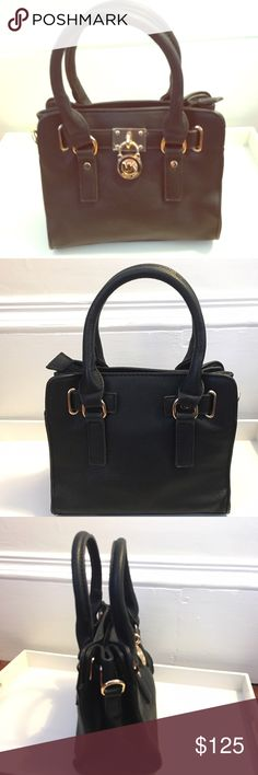 """Michael Kors Mini Hamilton Bag MK by Michael Kors mini Hamilton bag in saffiano black leather with chic, signature hardware accents. Double top handles, 5"""" drop Chain and leather shoulder strap, 10"""" drop Magnetic snap closure Protective metal feet One inside zip pocket Two inside open pockets Cotton lining 12""""W X 9½""""H X 5""""D. Like new condition. Plastic is still on hardware KORS Michael Kors Bags Mini Bags"""