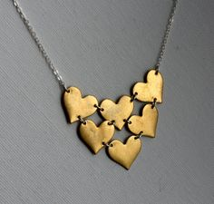 Handmade Heart Bib Necklace- Brass and Sterling Silver. $78.00, via Etsy.