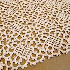 Venetian Table Runner - this blog post shows an example of the finished product with a link to the free crochet pattern from 1915