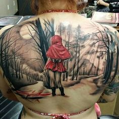 Girl with a Little Red Riding Hood & Wolf tattoo on her back