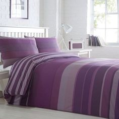 From our core Home Collection Basics range, this soft poly-cotton bedding set will suit a variety of different bedroom styles. In rich and comforting purple shades, it features an irregular striped print on the face and an alternative design on the reverse.