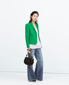 DOUBLECLOTH BLAZER WITH GOLD BUTTON from Zara.  Bright, short blazer + white blouse + wide-legged jeans.