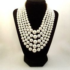 multistrand pearls with pink shirt - Google Search
