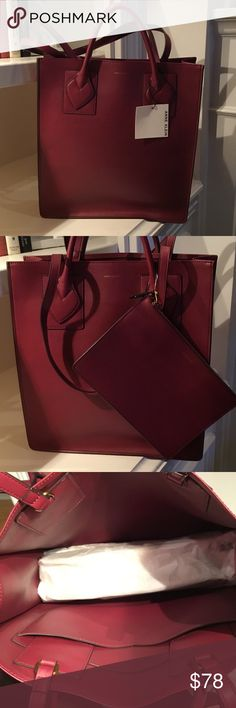 Anne Klein tote Beautiful tote shopper bag in a gorgeous rich burgundy color. This bag is great to carry everything you need to the office or when traveling. Large enough for a lap top or iPad and other essentials. 15.25 x 13.5 without handles Anne Klein Bags Totes