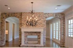 lovely view of brick arches and see-through fireplace from kitchen into living room/dining room . I like the brick arches but have much higher ceilings and would like a different fireplace. Living Room With Fireplace, Living Room Kitchen, Living Rooms, Fireplace In Kitchen, Living Spaces, Family Rooms, See Through Fireplace, Cedar Hill Farmhouse, Modern Farmhouse