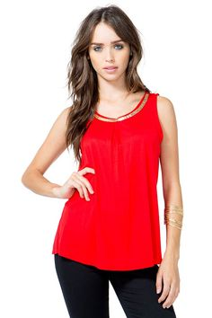 Unleash your sex appeal! An alluring chiffon top featuring a single pleat at front and open back with double button closure. Snaky gold chain embellishment at neck. Sleeveless. Loose fit. $14.50