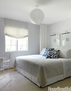 """""""I wanted to frame the bed with curtains so that it feels enveloping, like a room within a room. It's my modern version of a canopy,"""" says designer…"""