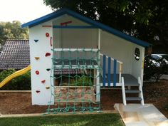 Custom Duplex cubby house.  Rock wall goes around 2 sides ... cargo net .. sandpit ... slide - so much fun!