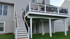 TREX deck (Firepit) w/ white vinyl rail & black aluminum ...