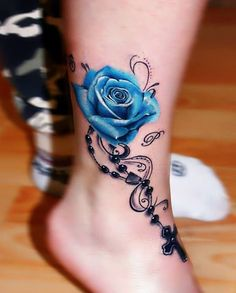 tattoos on back of ankle / tattoos on back ; tattoos on back of arm ; tattoos on back for women ; tattoos on back of neck ; tattoos on back shoulder ; tattoos on back of ankle ; tattoos on back of leg ; tattoos on back of arm above elbow 3d Rose Tattoo, Rose Tattoo On Ankle, Blue Rose Tattoos, Blue Tattoo, Tattoo Flowers, Rosary Ankle Tattoos, Butterfly Tattoos, Rosary Bead Tattoo, Flower Henna