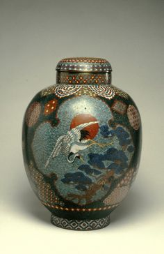 A nineteenth-century Japanese cloisonnné covered jar adorned with a depiction of a crane, pine and rising red sun, all symbols of longevity. (The Walters Museum)