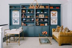 Custom-built shelving and cabinetry are painted in a rich teal hue. Cognac Leather Sofa, Leather Chairs, Black Leather, New Orleans Homes, Paint Brands, Formal Living Rooms, Color Of The Year, Elle Decor, White Walls