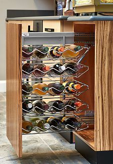 This wine pullout is the perfect addition for any wine enthusiast or kitchen gourmet. House twenty bottles of wine in Rev-A-Shelf's gorgeous European inspired organizer, perfect for Frameless, Face Frame and Inset cabinet applications. Wine Storage Cabinets, Inset Cabinets, Kitchen Drawer Organization, Tv Cabinets, Wine Pull, No Pantry Solutions, Drawer Inserts, Rev A Shelf, Kitchen Hardware