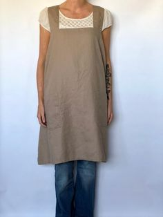 Japanese style smock apron made from eco linen fabric. Easy cross back style that simply slips over your head. No string ties and two roomy pockets in front.