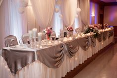 Head table and backdrop. wedding. blue uplighting. silver. bling. coral and navy.
