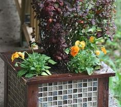 Make a Tiled Garden Container Planter for Frugal Upscale Decor use leftover tile from old house and pallets