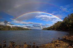 Batman Rainbows by Peter Daalder. Double rainbow over the Batman Bridge in Tamar Valley - Tasmania
