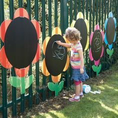 Outdoor Mark Making Chalkboard Daisies is part of Outdoor kids play area - Bright, attractive and weather resistant these colourful chalkboard daisies will transform dull playground fencing into an exciting and fun area Kids Outdoor Play, Outdoor Play Spaces, Backyard For Kids, Outdoor Fun, Diy For Kids, Outdoor Ideas, Childrens Play Area Garden, Backyard Ideas, Fence Ideas