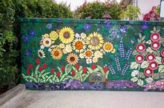 garden wall mosaic, I love the use of plates for the flowers