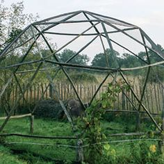 Our first dome made using old chestnut fenceposts, eyelets, coarse string, lots of glue and a big jig.