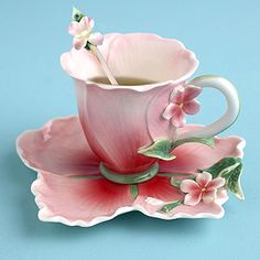 Flower tea cup, saucer and spoon.
