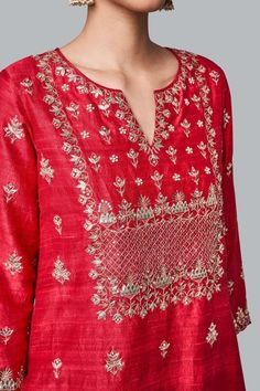 A red silk suit, intricately embroidered with our signature craft Gota Patti along with Pearls, zardosi and sequins. The motifs adorned on the Yutika Suit are inspired by the majestic architecture of Rajasthan's palaces. Embroidery Suits Punjabi, Kurti Embroidery Design, Hand Embroidery, Embroidery Stitches, Embroidery Patterns, Kurta Designs Women, Blouse Designs, Chudidhar Designs, Indian Designer Outfits