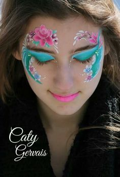 Beautiful eye face paint design. Love the colors!