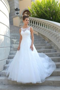 A-line gown with illusion bodice finished with lace, see through high back with zipper and buttons. Court length train.