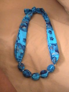 Put together this fabric necklace with a tube of your favorite fabric, some cord, a few unfinished wooden beads, and wire to hold the beads in place.