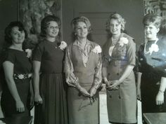 Why the clenched fist? Clothes were fab back then. Love the lady on far left.Vintage clothing