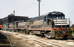 New Haven Railroad DERS-7 GE U25B locomotive # 2522 & DERS-8 ALCO C-425 locomotive # 2554 along with two more GE U25B's, are seen in the yard at Maybrook, New York, late 1960's, Mac Seabree Collection