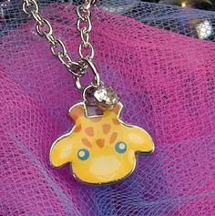 Kids Charm Necklace - Giraffe at theBIGzoo.com, an animal-themed store established in August 2000.