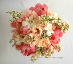Coral/peach bouquet featuring peonies, garden roses, stock, wax flower and orchids. Inspiration for bridal bouquet. (No orchids)