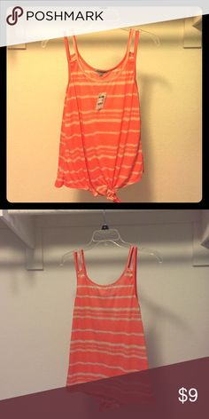 ✨Christmas Sale✨NWT Charlotte Russe Tank Top Charlotte Russe tank top with a tie at the bottom. Never worn with tags. 💯% Polyester. Charlotte Russe Tops Tank Tops