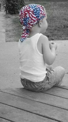 Title: Classic American Pride  Caption: This is my 3 1/2 year old son Banning. He was sitting on the back porch looking out at the feilds to the farm next door.