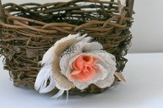flower girl basket?? I'm sorry. At first glance, I thought it was a bird that flew in to the side of its nest!