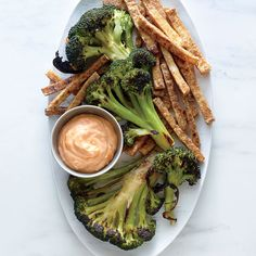 Here's a fun meat-free twist on steak frites: lightly charred broccoli steaks with crunchy tofu sticks and Sriracha aioli for dunking. (To make vegan, simply use vegan mayo)