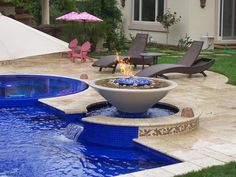 This stunning fire bowl combines with water that spills into the spacious swimming pool below.
