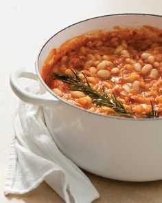 If the stew is made in advance, be sure to remove the rosemary sprig and let the beans cool before refrigerating. It should be reheated gently over medium-low heat.