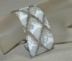 Oh, I so love this design! Dragon Scales, Winter Ice ... Peyote Bracelet . Crystal . Pearl . Carbon Steel . White . Snow . Gray . Brilliant . Shine . Sparkle. $55.00, via Etsy.