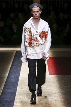 Prada menswear F/W 2016-2017 Milan Fashion Week. Prints on the Shirts. ADam Eva, apple? Myths, bunch of keys, apple and garden