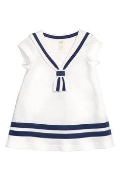 Vestido à marinheiro: Vestido em jersey macio de algodão com mangas curtas e gola à marinheiro.