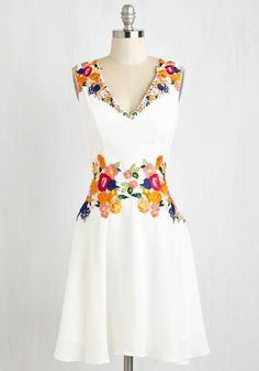 Queen of the Conservatory Dress. Like a wearable floral fantasy, this bright white dress by Chi Chi London is overflowing with vibrant blossoms and blooms! #white #wedding #modcloth
