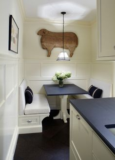 Very chic and cozy place to dine...the panel molding and details creates depth and interest   John B. Murray Architect: